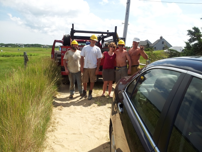 The construction crew from down the street saved the day by pulling her car out of a sand pit.  Thank you kind gentlemen.