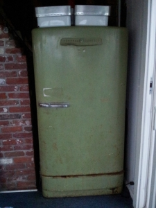 the very handy avocado green beer fridge on the porch