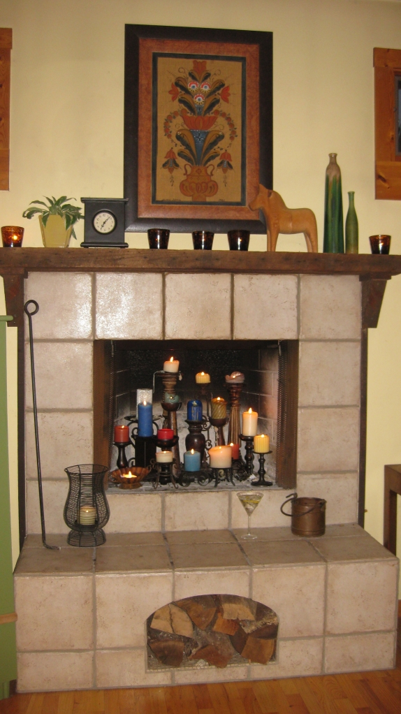 Fireplace colored candles close martini glass