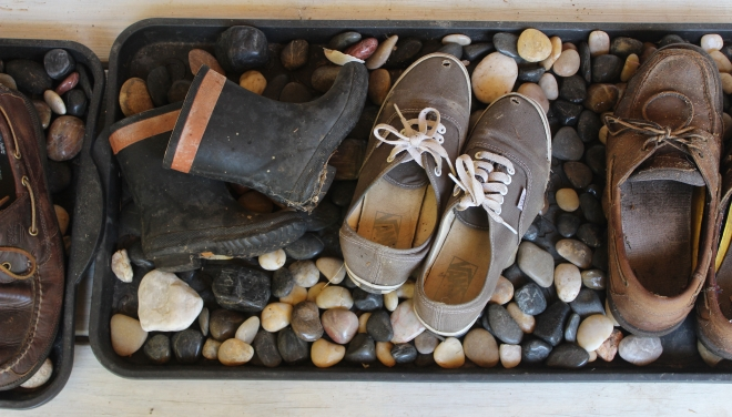 Peaks Island shoes on boot tray lined with beach stones