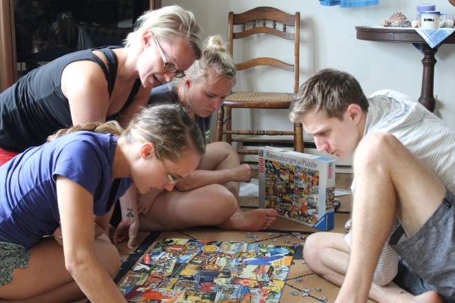Summer kids doing puzzle