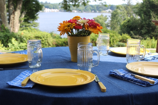 Summer Table setting with zinnias on the deck