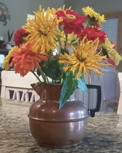 Zinnias in Copper Pitcher